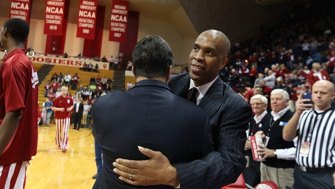 Former Indiana University head basketball coach Mike Davis, right, gets a big hug from current head coach Tom Crean as he enters Assembly Hall before the game between the Hoosiers and his current team, the Texas Southern Tigers, in Bloomington on Monday, Nov. 17, 2014. Davis took over the program after Bobby Knight was fired in September 2000 and left IU after the 2005-06 season.