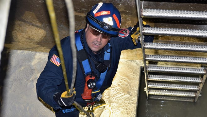 Vineland Firefighter Carlos Mercado takes part in a well rescue drill at a city pumping station Thursday morning.