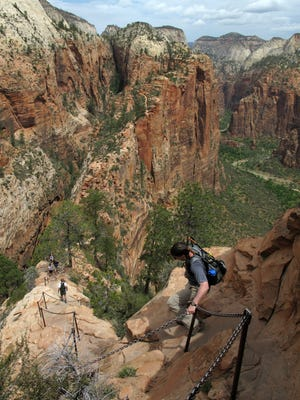 Hikers climb down the Angel's Landing Trail in Zion National Park, May 8, 2011. Crowds are flocking in record numbers to Zion National Park this year, with visitation up 28 percent in the first quarter of 2015. On Wednesday, park officials said the higher usage is putting more pressure on park resources to keep up.
