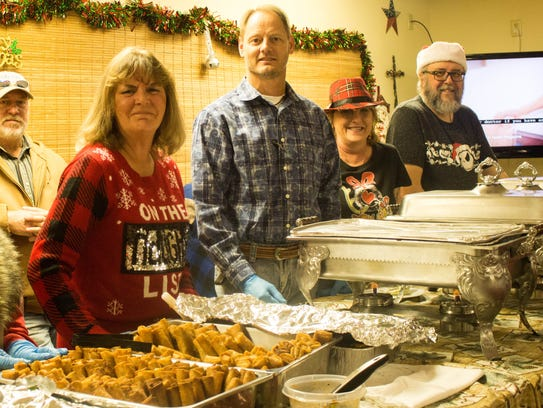 Volunteers serve food to military personnel from Goodfellow