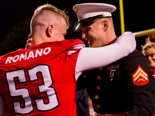Senior Kyle Romano, 53, hugs his brother Chad Romano, who surprised him to watch the game against Eastern Illinois on November 18, 2017.