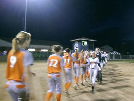 Mandarin players shake hands with University players after Thursday night's games.