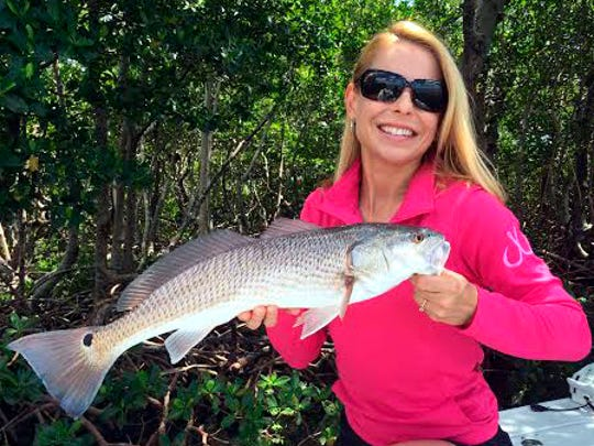 Debbie Hanson's redfish hit a live shrimp pitched near an Estero Bay oyster bar, while fishing with Snook Stamp Charters Capt. Greg Stamper.