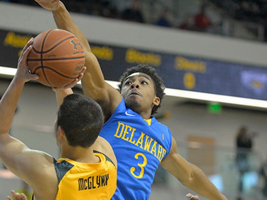 Delaware's Anthony Mosley (3) tries to thwart Towson's Four McGlynn on his drive to the hoop Saturday in Towson, Md.