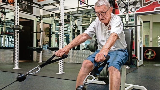 """Art Ballard performs seated cable pulls during his workout at Foothill Gym in Monrovia, California, a few weeks before the gym was officially open to the public. """"I'm feeling so good,"""" he says. """"I snapped back."""""""