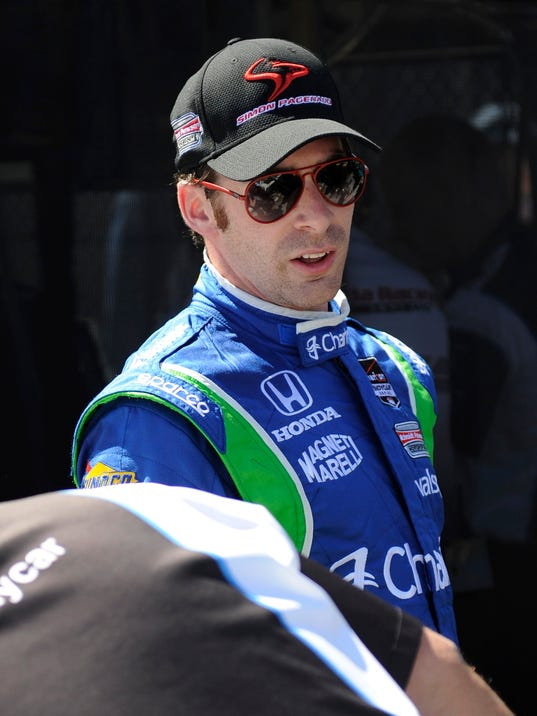 Simon Pagenaud, of France, leaves the track after the practice for IndyCar's Toyota Grand Prix of Long Beach auto race in Long Beach, Calif., Friday, April 11, 2014. (AP Photo/Kelvin Kuo)