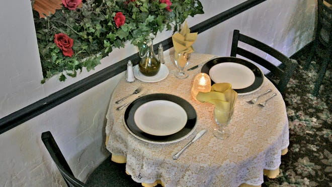 A favorite couples table at Mama Carolla's is this one located in a nook upstairs, known as the Gold Room, in what was once a bedroom of the home.