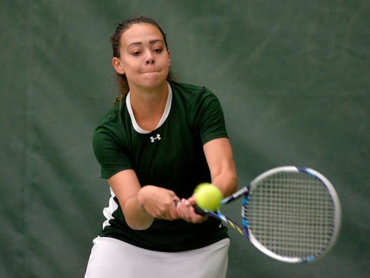 CMR's Mackenzie George goes to her backhand during