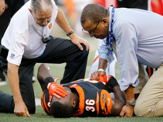 Cincinnati Bengals safety Shawn Williams (36) is examined by the medical staff before leaving the game in the second quarter of the NFL Preseason Week 2 game between the Cincinnati Bengals and the Kansas City Chiefs at Paul Brown Stadium in downtown Cincinnati on Saturday, Aug. 19, 2017. At halftime the Bengals trailed 16-9.