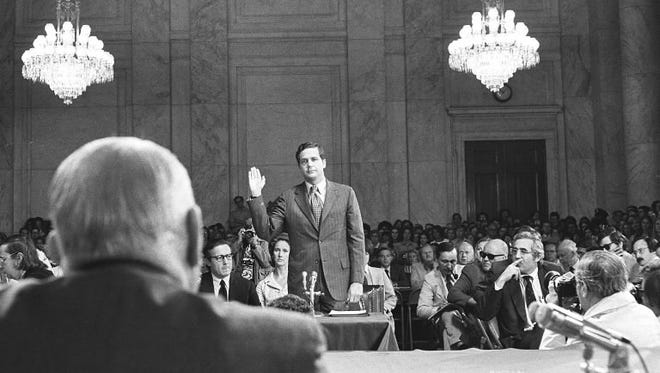 Jeb Magruder, center, being sworn in before testifying before the Senate Watergate Committee in June 1973.
