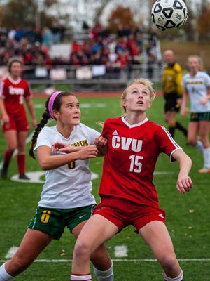 CVU's Sierra Morton, right, and Burr & Burton's Georgia Lord eye the ball in the Division I girls soccer championship in Burlington on Saturday, October 31, 2015.