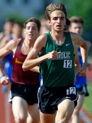 Catholic's Jake Renfree leads the pack during the 2018
