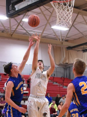 Maysville's Carson Jarrett tries to block a shot from Coshocton junior Griffin Mason. The Panthers won 55-50 on Tuesday, Jan. 30, 2018.