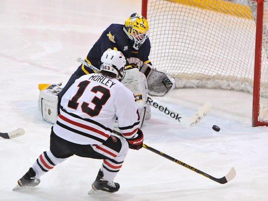 Quinnipiac goaltender Michael Garteig makes a save