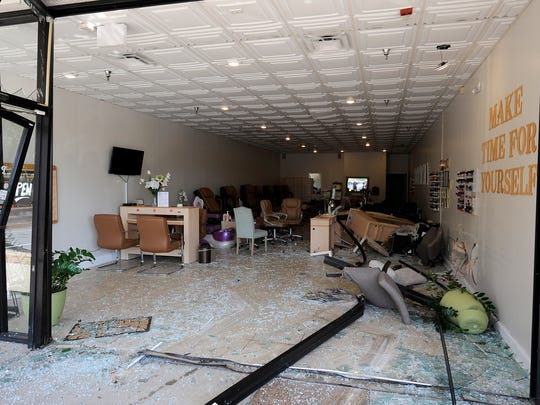 The damage after an SUV drove into Polished Salon off of Union University Drive is seen in Jackson, Tenn., on Thursday, Sept. 22, 2016.