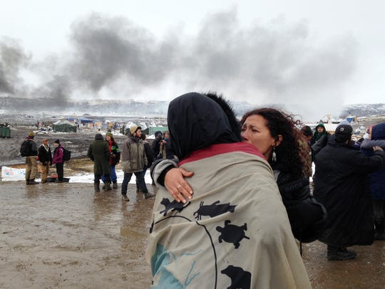A couple embraces as opponents of the Dakota Access