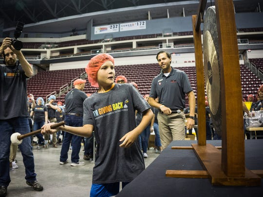 Grayson Kunkel, 10, of Hummelstown rings the gong as