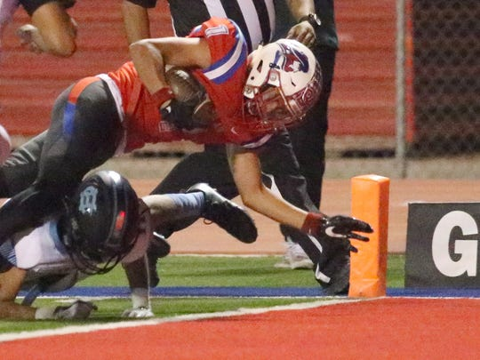 Bel Air wide receiver John Diaz, 1, reaches the end zone for a score against Chapin earlier this season at Bel Air.