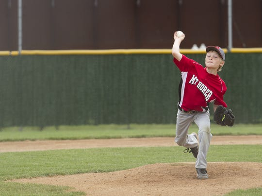 Mount Horeb's Cody Anderson, 10, pitches during the Small Town Baseball tournament at Steve J. Miller Recreation Area in Marshfield, Friday July, 11, 2014.