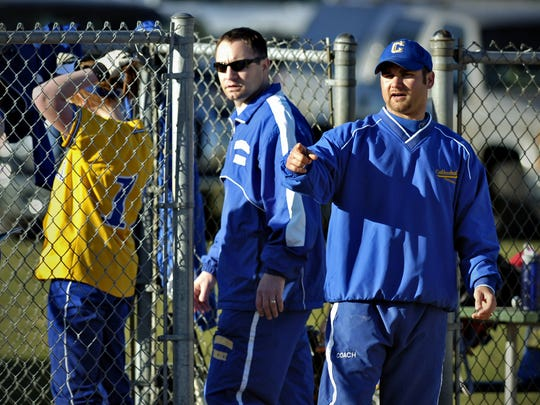 St. Cloud Cathedral softball co-coaches Eric Johnson (left) and Mark Chamernick (right) direct players during a game in 2010 at Whitney Field. Chamernick has coached Cathedral softball for the last nine years and he will be the Crusaders' head football coach for the third year this fall. He was named the St. Cloud Icebreakers head girls hockey coach on Tuesday. He was the Icebreakers head coach from 2005-15.