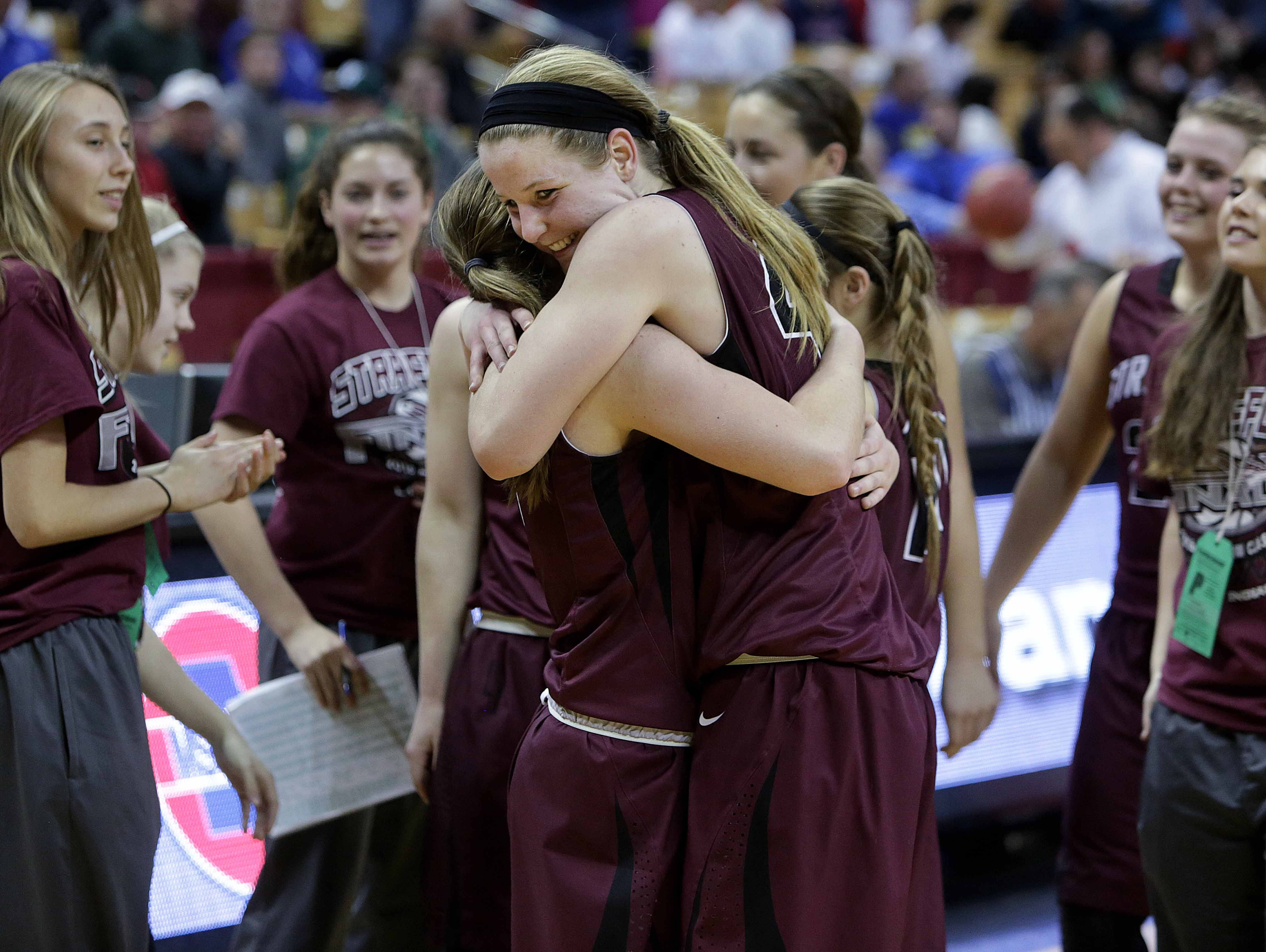 Hayley Frank of Strafford, right, hugs teammate Abby Oliver after the Indians defeated St. Pius X 48-37 in the 2016 Class 3 girls basketball semifinals on in Columbia.