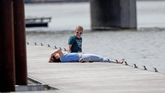The sunshine on May 14 brought dozens of people to the CityDeck area in downtown Green Bay to soak up the rays before heading back to work.