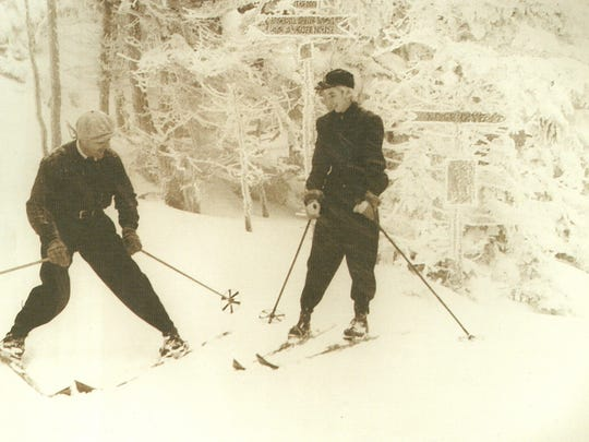 Sepp Ruschp teaches a private lesson around 1940 at the top of the Nose Dive trail. Ruschp taught the Arlberg Technique and was known as a smooth and elegant skier.