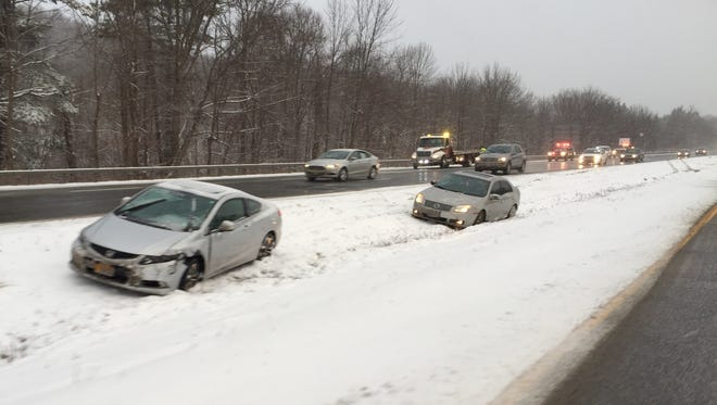 Some cars slid off the side of the highway on southbound 684 just south of Exit 8.
