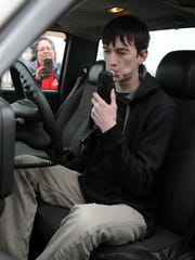 Patrick Hewitt tests an ignition interlock Monday at the Ohio Highway Patrol Lancaster Post. Hewitt and members of the Lancaster High School marching band were recognized for their efforts to raise money for Walk like MADD, a fundraising event for Mothers Against Drunk Driving.