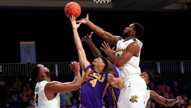 LSU Tigers guard Skylar Mays (4) and Wichita State Shockers center Shaquille Morris (24) battle for the ball during the first half in the 2016 Battle 4 Atlantis in the Imperial Arena at the Atlantis Resort.