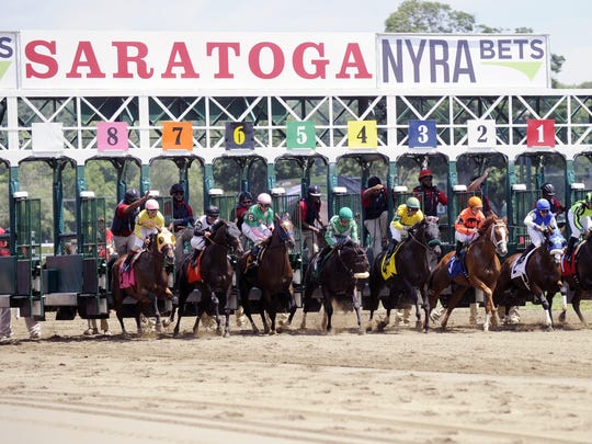 Horses break from the starting gate during the first race on opening day of the season at Saratoga Race Course in Saratoga Springs on July 22.