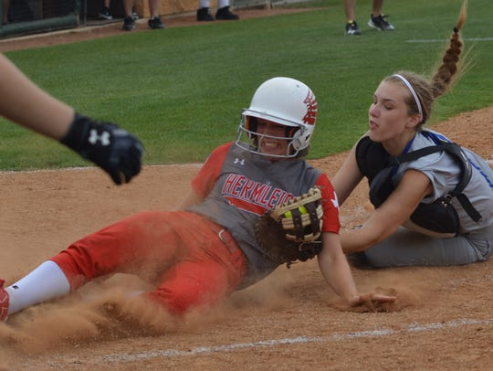 Hermleigh's Kelsey Digby is tagged out at the plate