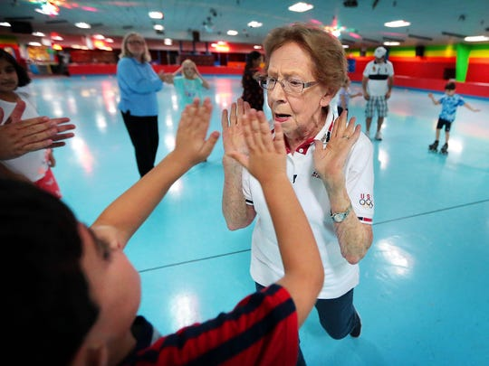 87-year-old roller skating instructor Caroline Mirelli  moves in for a high-five with student Bardita Yaghini while playing the Hokey Pokey during a skating class at the Cordova Skating Center. Mirelli is what scientists consider a 'superager' which is a term used to describe someone who has the physical and mental capabilities of a much younger person, usually because they continue to challenge themselves as they age to keeping their brain active.