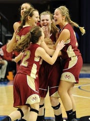 Ashlynn Spahn, front left, Tori Schickel, left center, Brianna Dickerson, back left, and Casey Jochem, right, surround Maura Muensterman, center, after she made the game winning shot in overtime against Fort Wayne Bishop Luers in the 2A girls' state championship basketball game at the Hulman Center in Terre Haute, Ind., on Saturday, March 3, 2012.