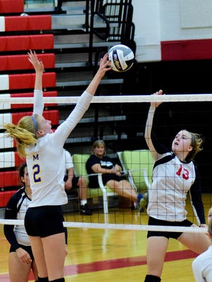 Madeira's Emma Fortman (2) is successful with a kill as she spikes past Indian Hill's Christina Shannon (13) on Oct. 8.