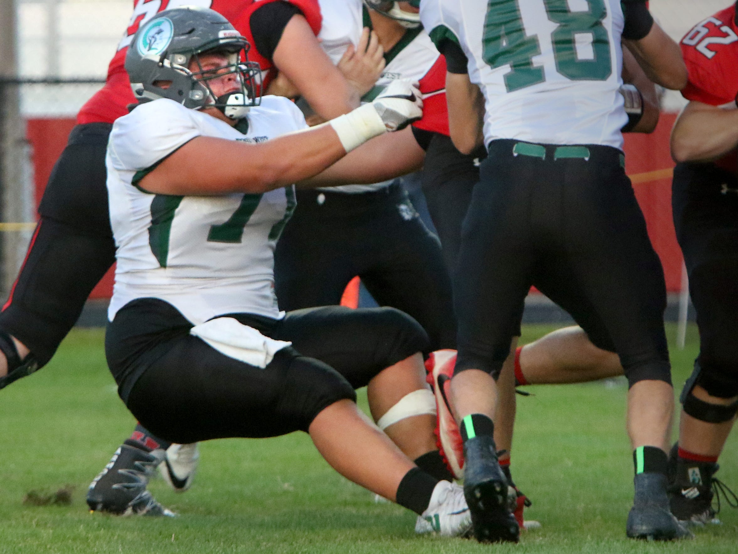 Wauwatosa West's Austin Ertl hangs on to drop Sussex