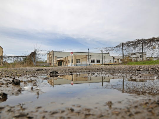 The former Dico plant, a heavily contaminated and abandoned manufacturing plant on the Raccoon River, Friday, May 2, 2014. The Des Moines school district is considering a plan to build a new stadium at the plant.