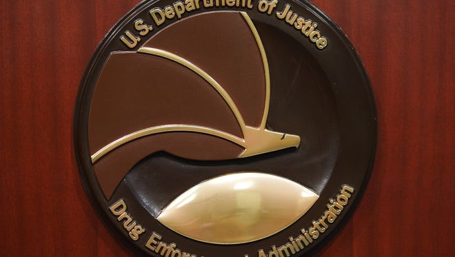 The seal of the Drug Enforcement Administration is seen on a lectern before the start of a press conference at DEA Headquarters on June 26, 2013 in Arlington, Virginia. AFP PHOTO/Mandel NGAN        (Photo credit should read MANDEL NGAN/AFP/Getty Images)