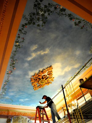 Artist Phil Carroll takes care painting the ceiling in the Central Parlor at Belmont Mansion. The parlor is being restored to the way it looked when original owner Adelicia Acklen lived there in the 1800s.