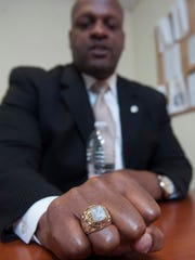 Former Philadelphia Eagle Ron Moten is now deputy chief of detectives for the Camden County Prosecutor's Office, where he's worked for the past 19 years. Above: Moten proudly wears his class ring from Rutgers-Camden, where he graduated after an injury ended his football career.