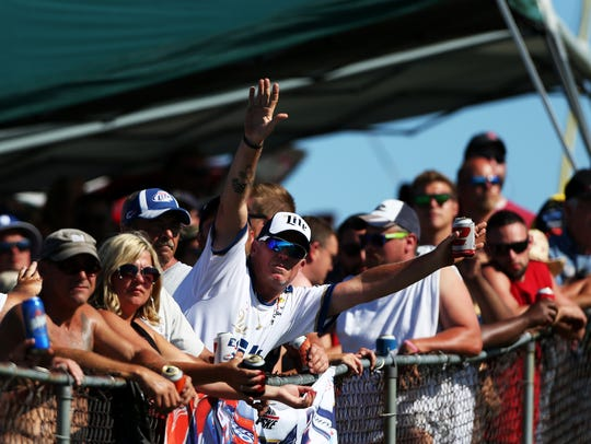 WATKINS GLEN, NY - AUGUST 09: Fans cheer during the