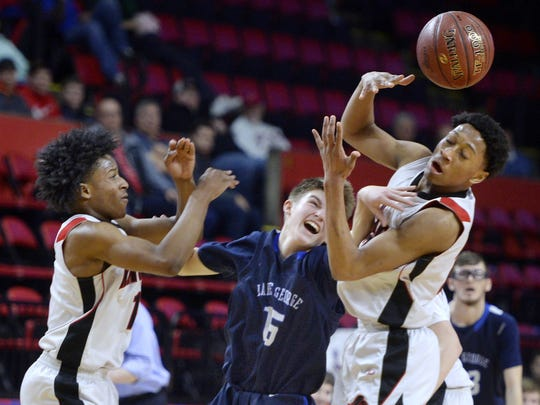 Northstar Christian's Miles Brown, right, and Michael Brown, left, fight for a loose ball against Lake George's Alex Jones during the state Class C boys basketball semifinal.
