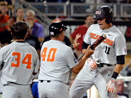 Jun 27, 2018; Omaha, NE, USA; Oregon State Beavers right fielder Trevor Larnach (11) reacts after hitting a home run during the ninth inning against the Arkansas Razorbacks in game two of the championship series of the College World Series at TD Ameritrade Park. Mandatory Credit: Steven Branscombe-USA TODAY Sports
