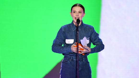 "The front of Millie Bobby Brown's shirt says: ""Never"
