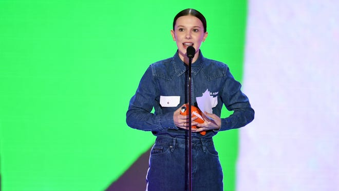 """The front of Millie Bobby Brown's shirt says: """"Never Again"""""""