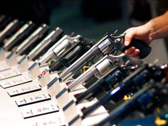 In this Jan. 19, 2016 file photo, handguns are displayed