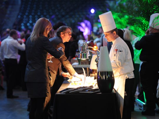 Chefs prepared dishes for guests to sample during last year's Corks and Forks Gala at Bankers Life Fieldhouse, benefitting Second Helpings.