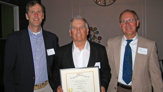 """From left, Ray Byrne, president of the University of New Mexico's Sigma Xi Chapter, Farmington consulting geologist David Taylor and UNM Sigma Xi Chapter Secretary Mike Jackovich stand for a photo on May 16 in Albuquerque. Taylor received the chapter's """"Noteworthy Technical Support Person Award for 2016."""""""
