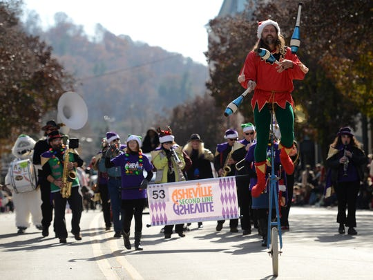 The 68th annual Asheville Holiday Parade on Saturday, November 22, 2014, brings a large crowd to downtown area of Asheville, NC.