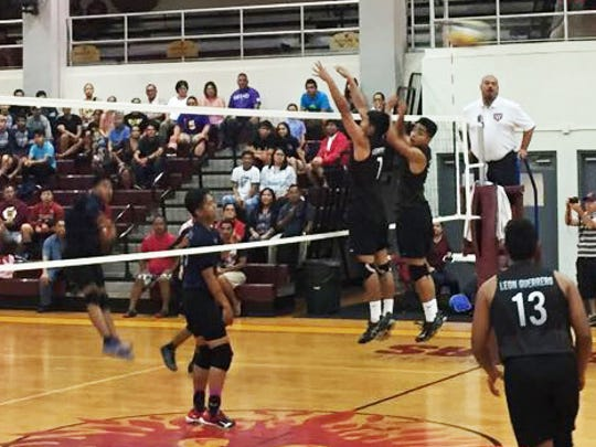 Friar Brandon Mendiola and Noah Diaz go up for the  block as a spike from Okkodo soars over the net. Friar Vincent Leon Guerrero (13) prepares for return a spike on April 25, 2017, at the FD Phoenix Center.